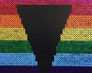Max logo made from ribbons of pride colours