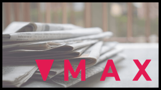Max logo placed over a stack of newspapers