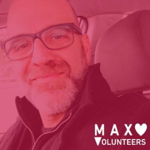 MAX Volunteer with red filter over