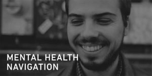 Man smiling looking at the words Mental Health Navigation